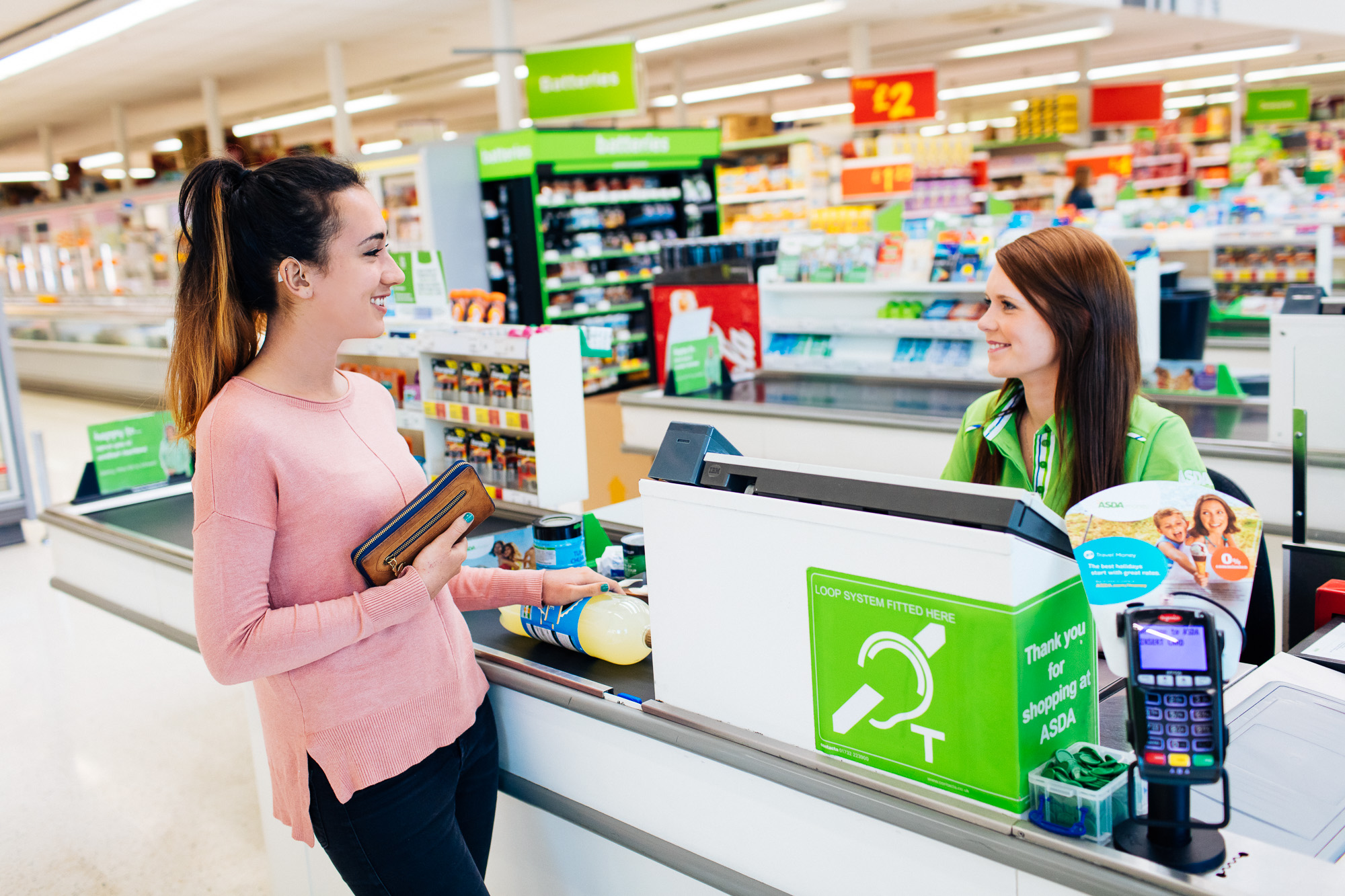 Supermarket shoot in Asda for Contacta, showing their Hearing Loop in use